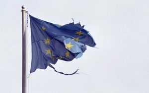 A5KKEE damaged european union flag flying on pole